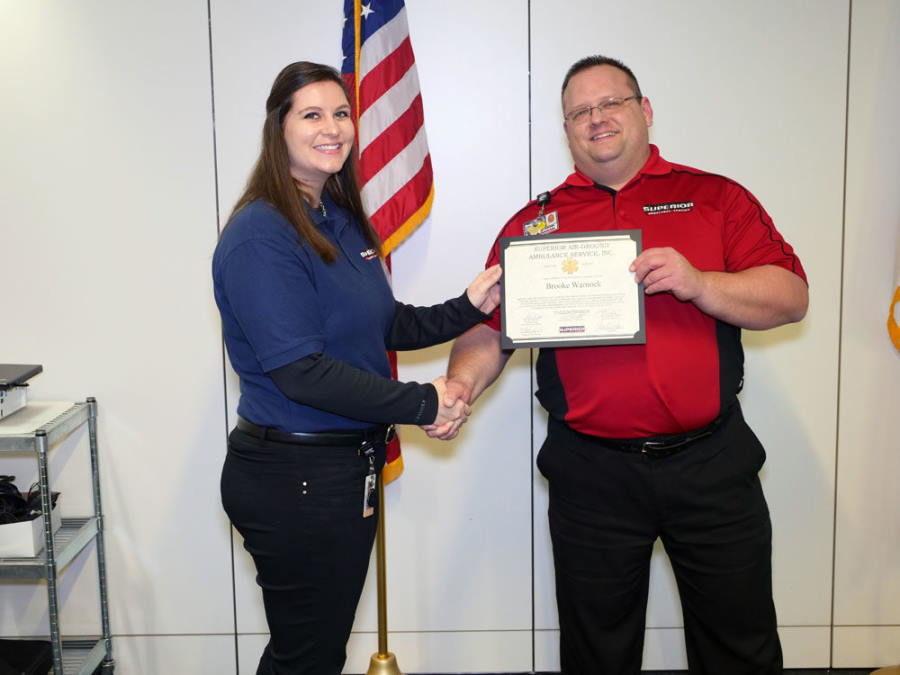 EMT Instructor Presenting Diploma to EMT Student
